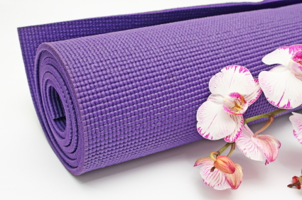 yoga mat and flowers